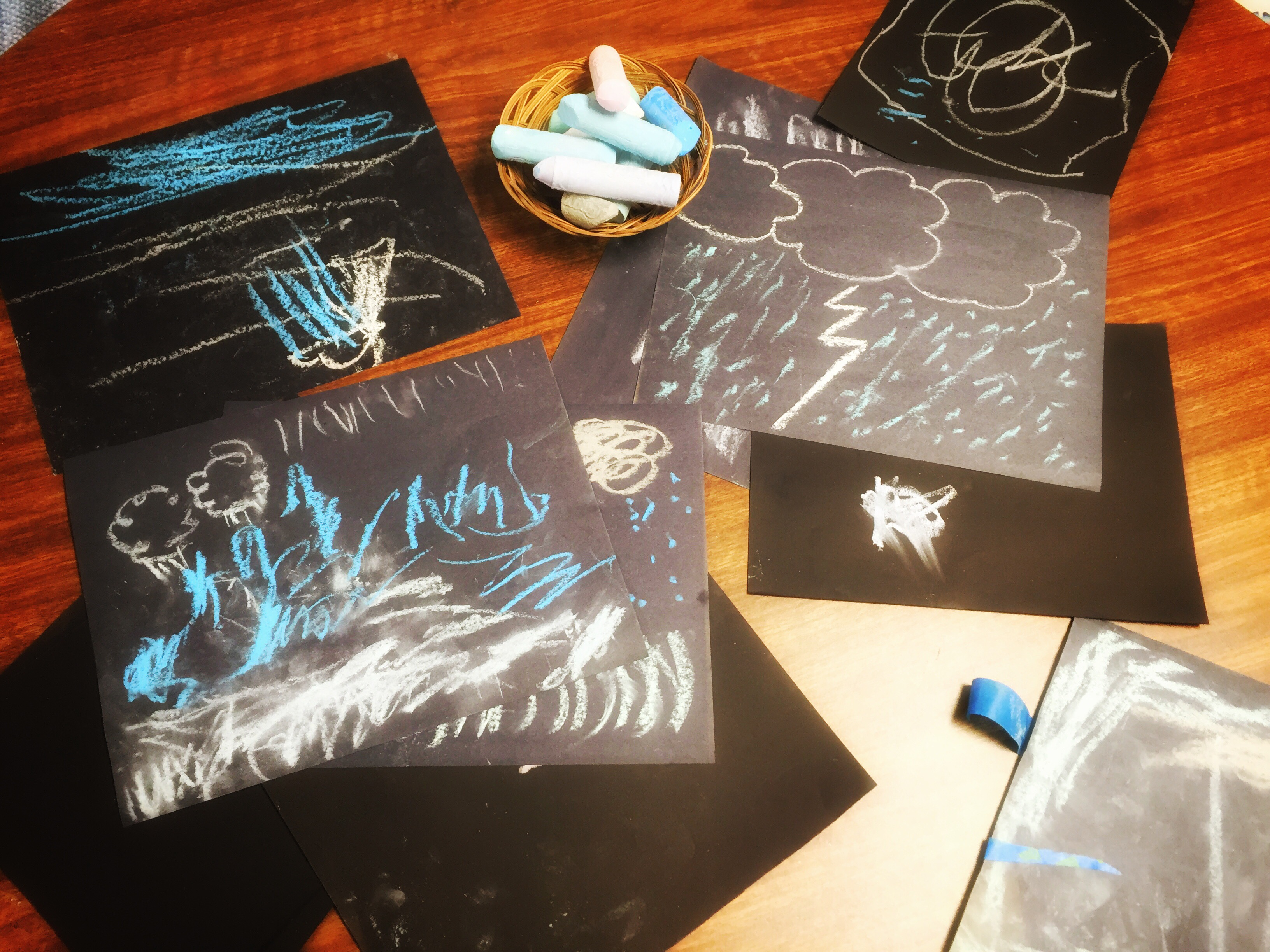 preschool art invitation - draw a storm- chalk on black paper